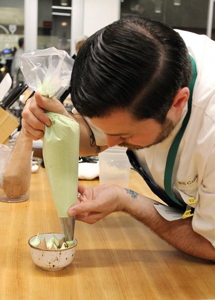 Corbett piping the basil meringue. (Photo by Carolyn Jung)