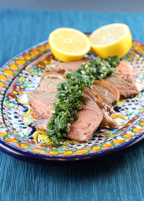 Rosy slices of lamb topped with a vibrant salsa verde.