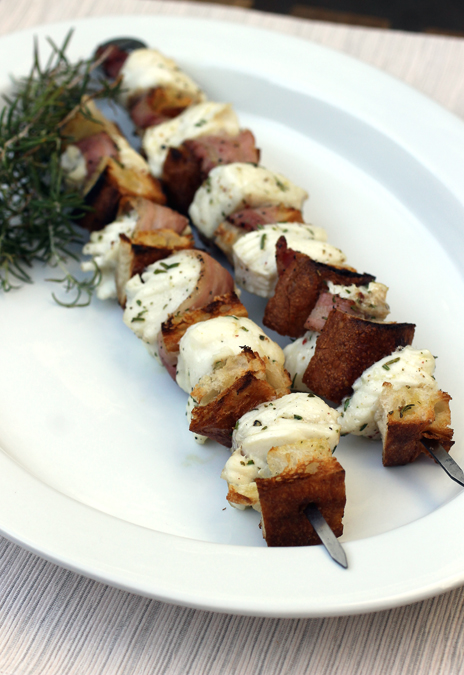Snowy white halibut chunks get grilled with pancetta and artisan bread cubes for a taste sensation.
