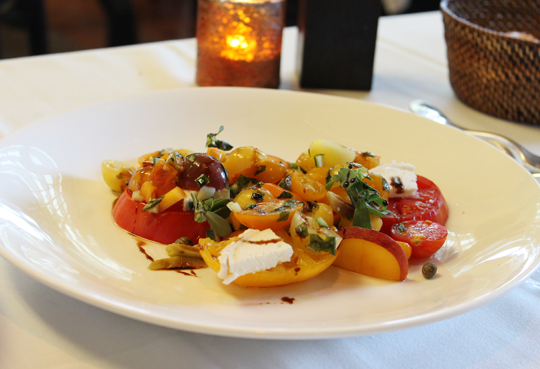 Heirloom tomatoes with goat cheese and peaches.