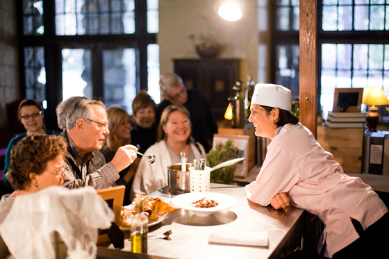 "Chef Ariane Duarte of ""Top Chef'' fame talks with attendees at a previous Chefs' Holidays cooking demo. (Photo courtesy of the Ahwahnee)"