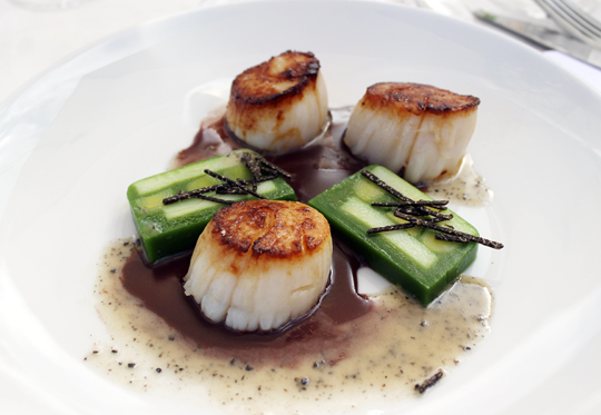 Perfect day boat scallops with a mosaic terrine of potato, leek and black truffle.