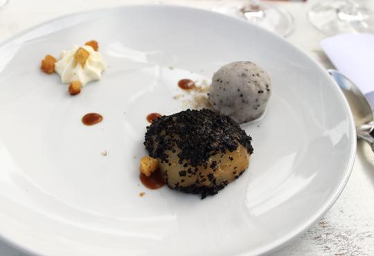 Bartlett pear covered with truffle alongside truffle sorbet.