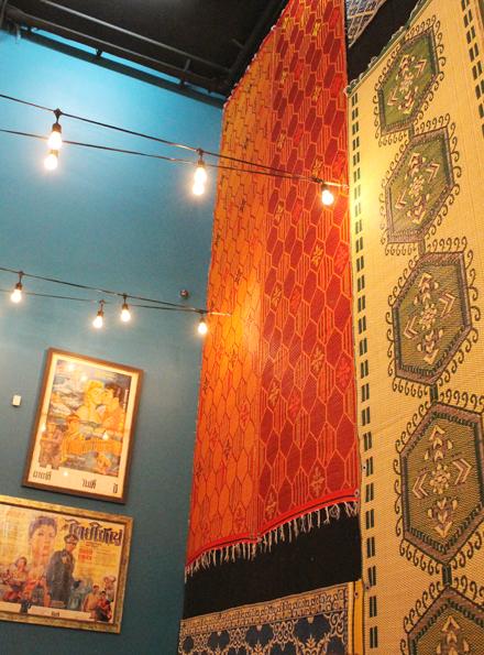 Colorful mats as wall art.