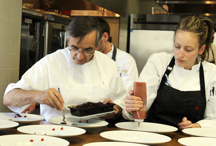 "The incomparable Chef Michel Bras (left) is assisted in plating a dish for the ""Taste of France'' lunch."
