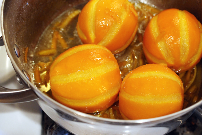 The oranges simmering in sugar syrup.