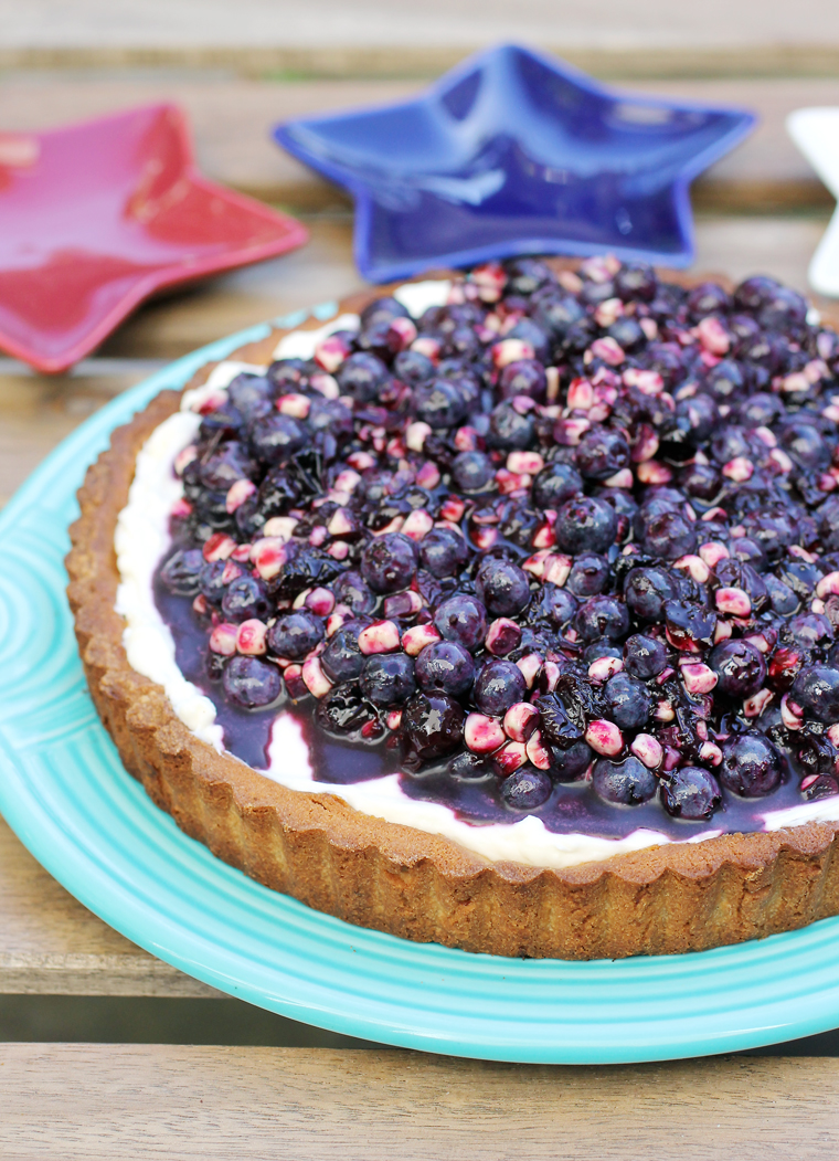A dazzling tart topped with blueberries and corn. Yes, corn!