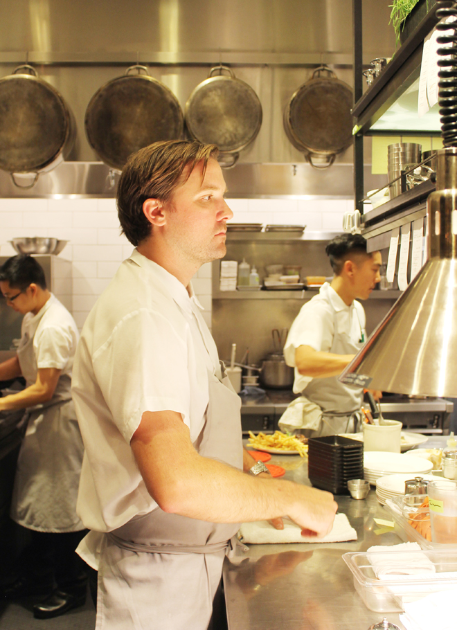 Chef Jason Berthold deep in concentration in the kitchen.