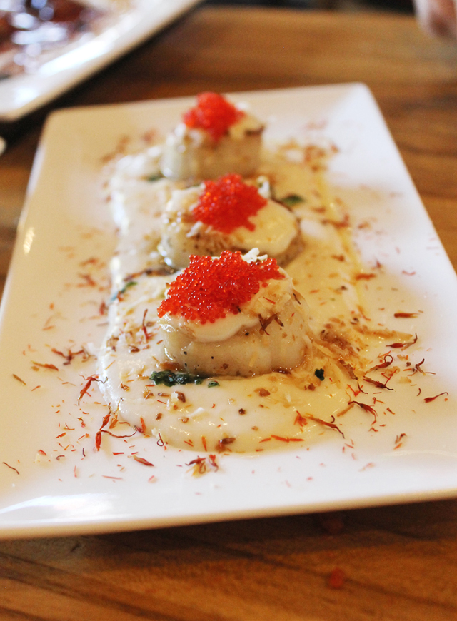 Scallops with a creamy coconut-lychee sauce. (Photo by Carolyn Jung)