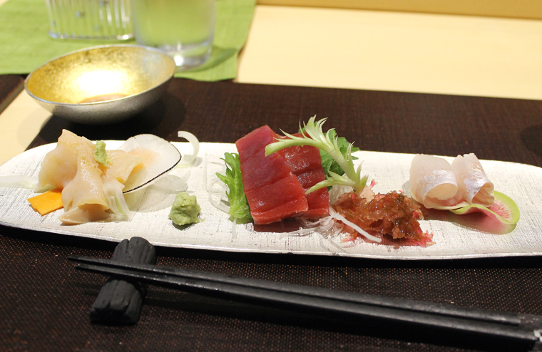 Sashimi trio with red seaweed.