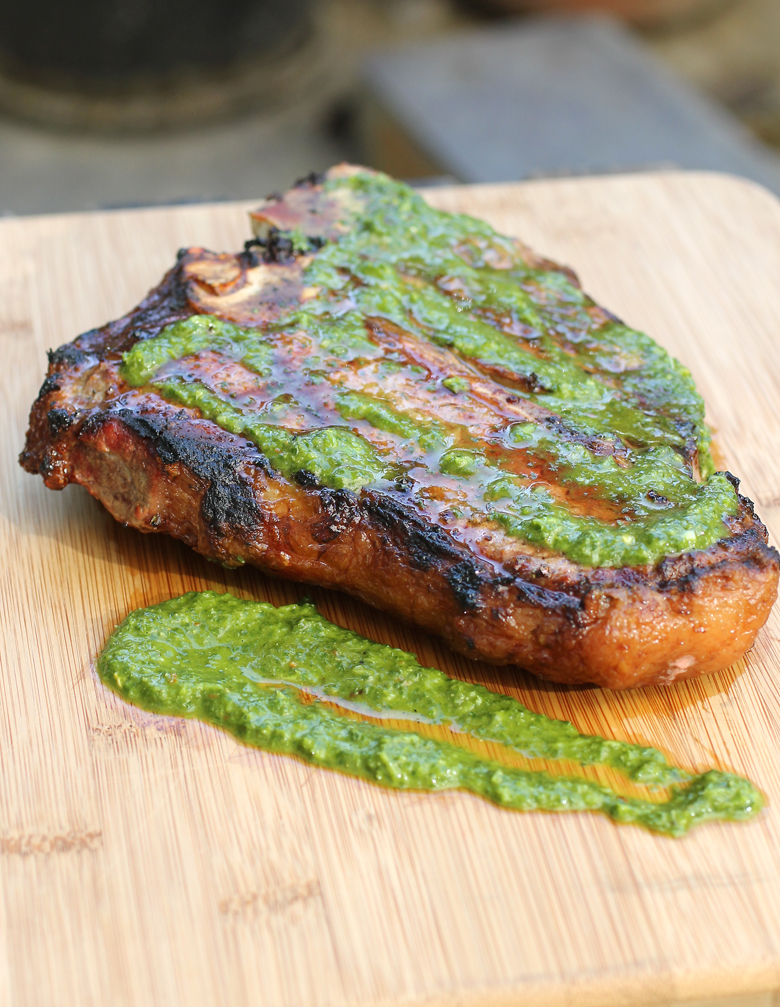 Snake River Farms porterhouse steak gets glam with homemade chimichurri sauce.