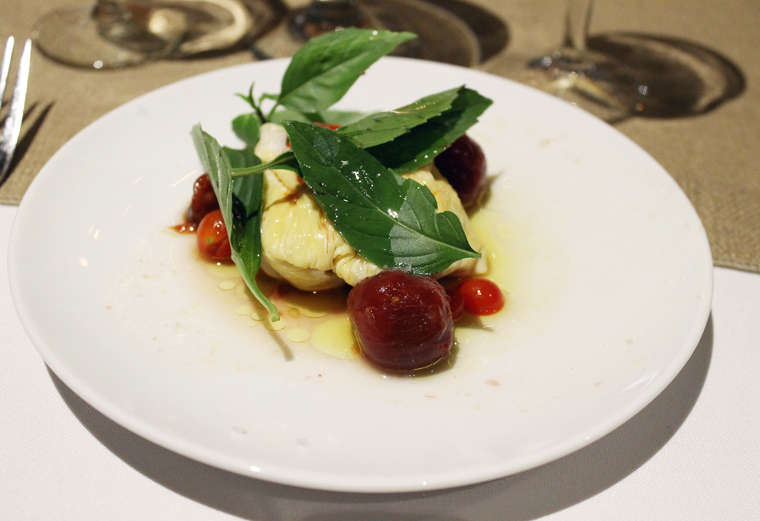 "Tofu ""burrata'' with dry-farmed tomatoes, Thai basil and olive oil."