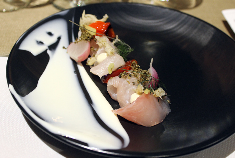 Chef Omri Aflalo's kampachi crudo with somked tofu gel, kefir yogurt-silken tofu puree, compressed radish, and scallion ash.