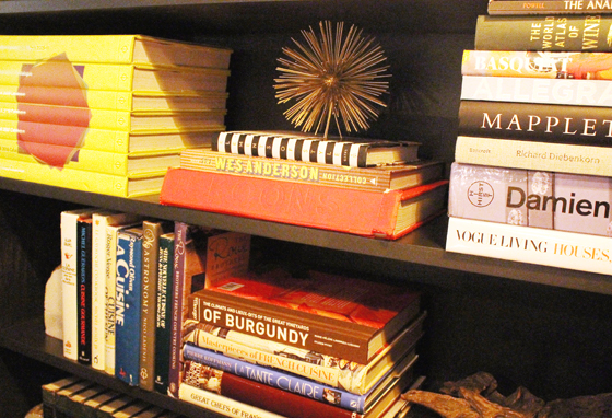 Art, wine, and culinary books fill a nearby bookcase.