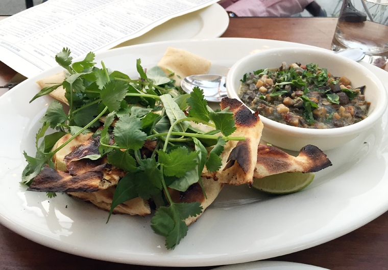 Flatbread with saucy snails.