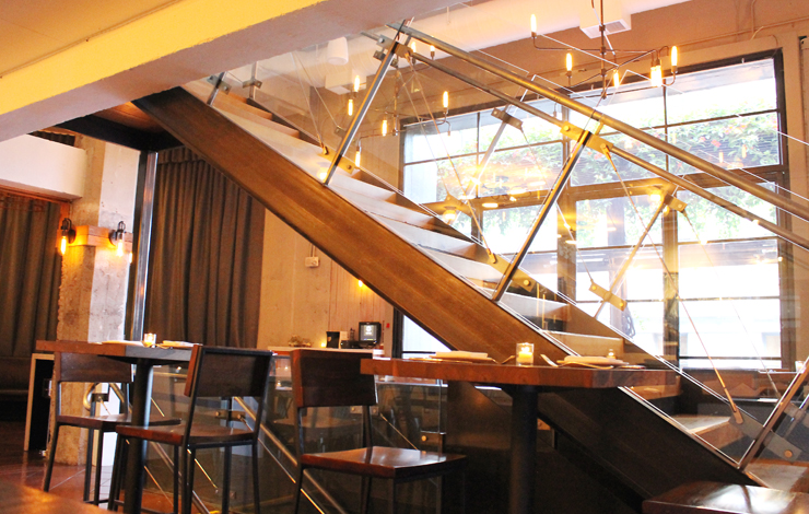 The sleek staircase that bisects the main dining room.
