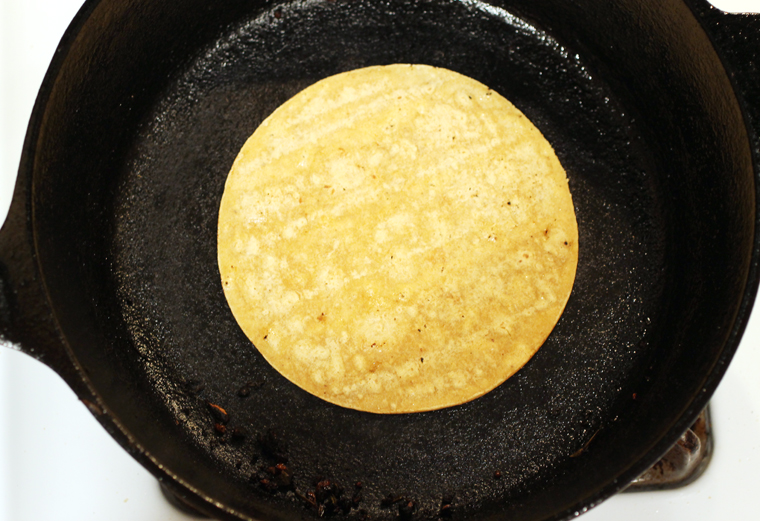The corn tortillas get warm and slightly puffy.