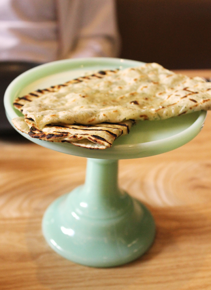 Roti on a cute little cake stand.