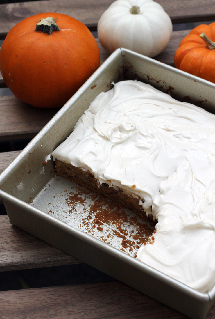 Pumpkin spice bars with a cloud of fluffy, marshmallow-y cream cheese frosting.