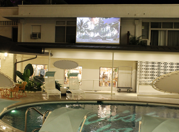 Movies pool-side at night.