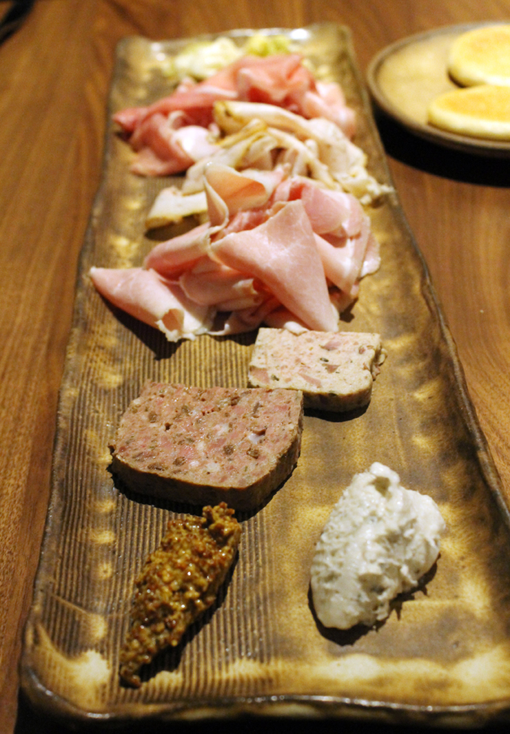 A sampler of charcuterie (almost all house-made) on a one-of-a-kind plate at Pausa.