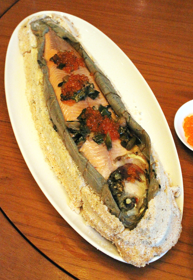 The whole trout, wrapped in lotus leaves and cooked in a salt crust.