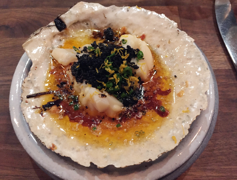 Scallop with squid ink crumbs.