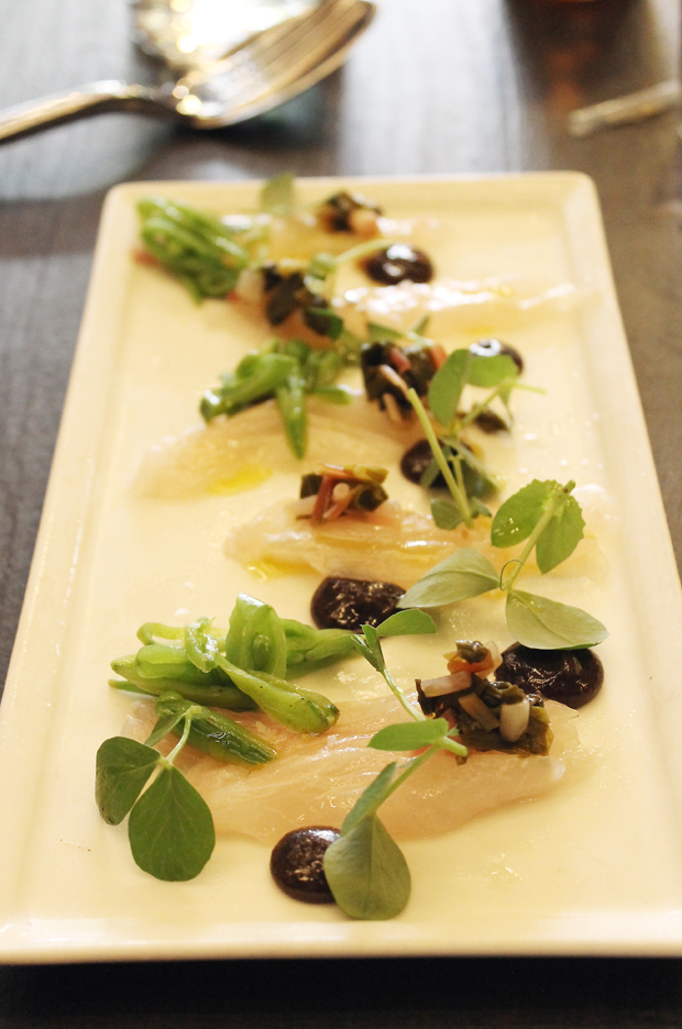 Crudo dolloped with black garlic.