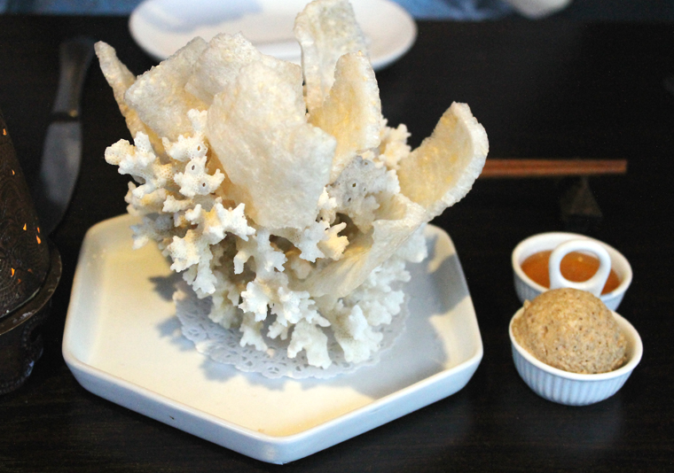 Humble rice crackers given a dramatic plating.