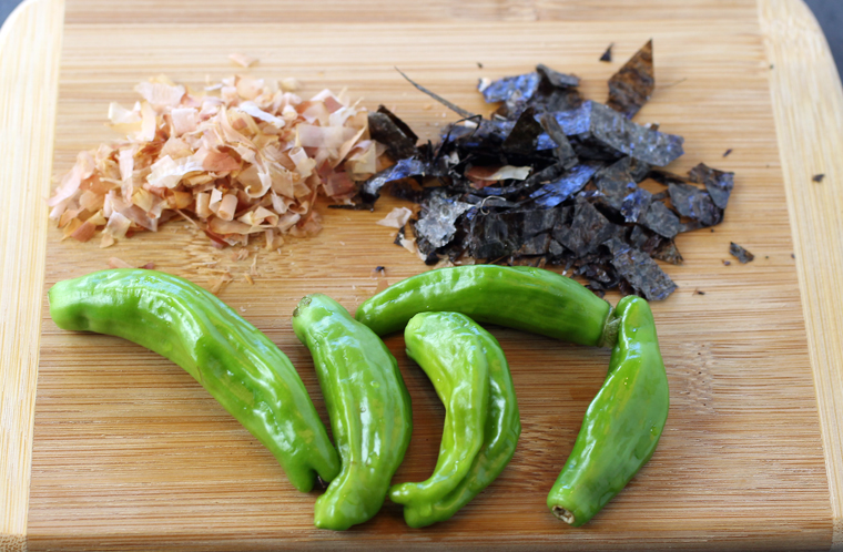 Fresh shishito peppers (front), and bonito flakes and nori (back).