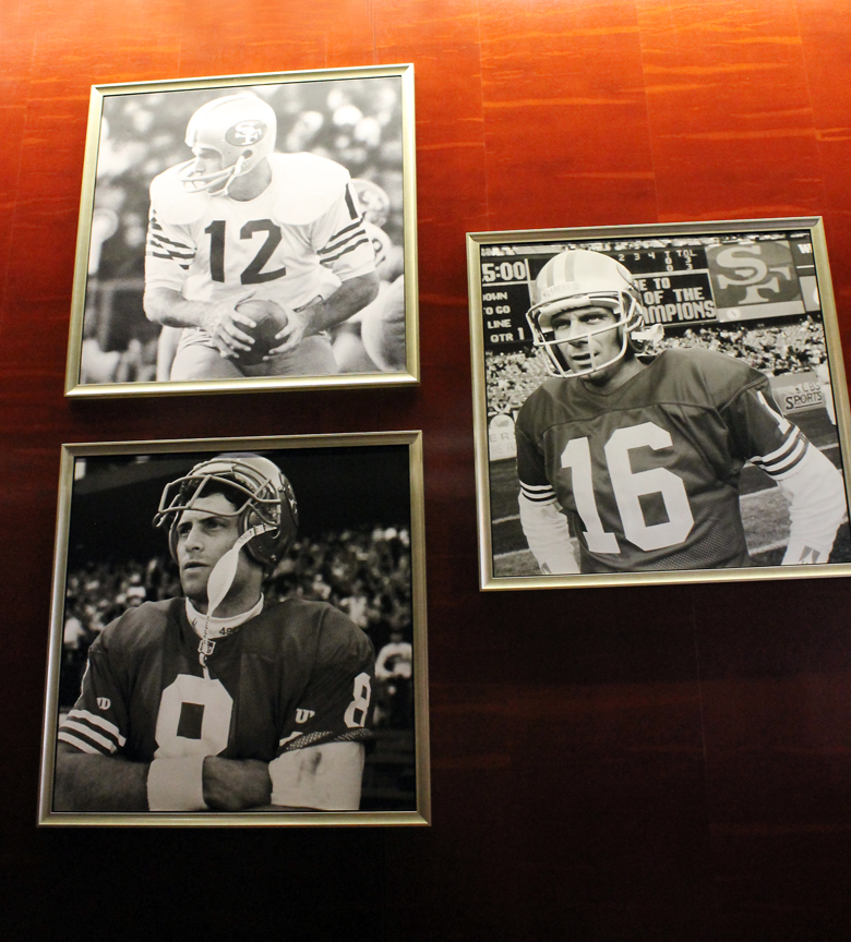 The greats on the wall at the BNY Melon Club West at Levi's Stadium.