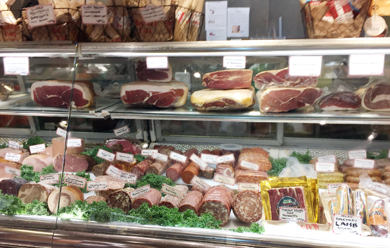 A wide assortment of cured meats for sale at Market Hall Foods.