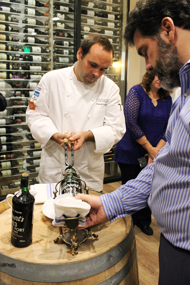 David Costa and Carlos Carreira opening the bottles of vintage port.