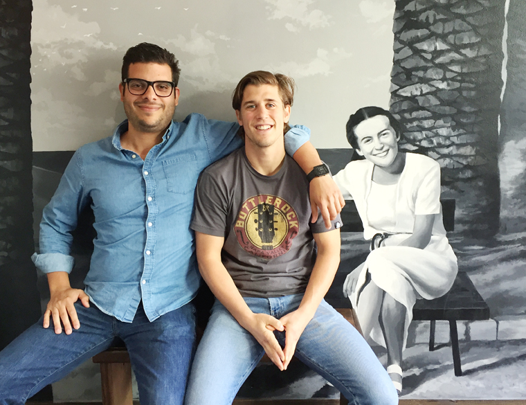 Founders Antonio Massimini and Henri Waltenspühl beside a mural of Henri's grandmother, for whom the shop is named.