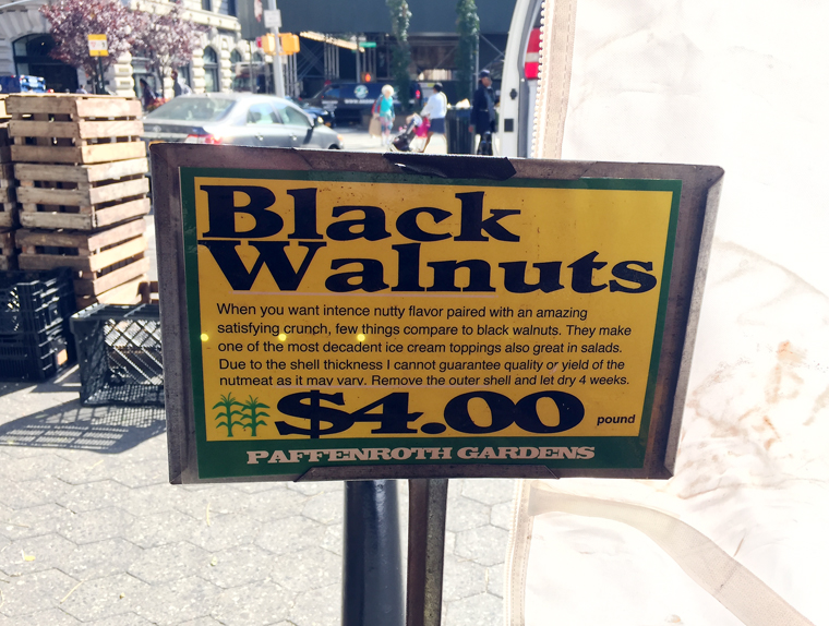 Another stand selling black walnuts.