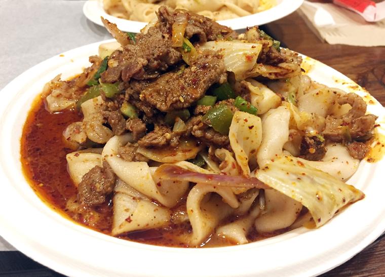 Hand-ripped noodles tossed with spicy cumin lamb.
