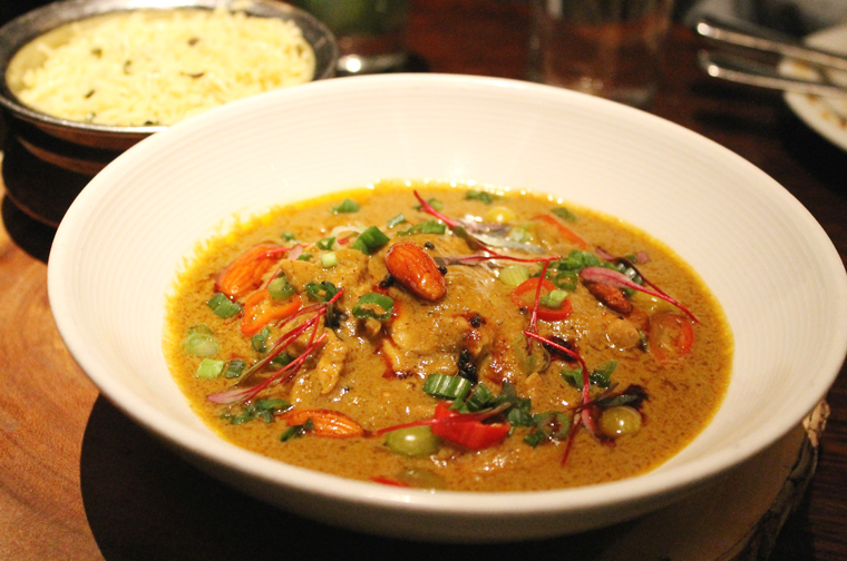 Chicken curry shaken up with the addition of almonds.
