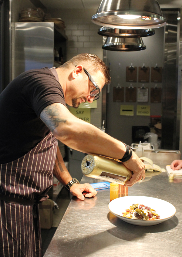 Chef Chris Cosentino in the kitchen at Acacia House. (photo by Carolyn Jung)