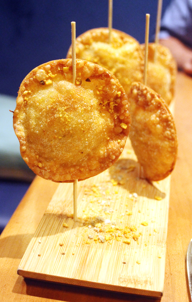 Chicken empanadas on a stick at Teleferic Barcelona.