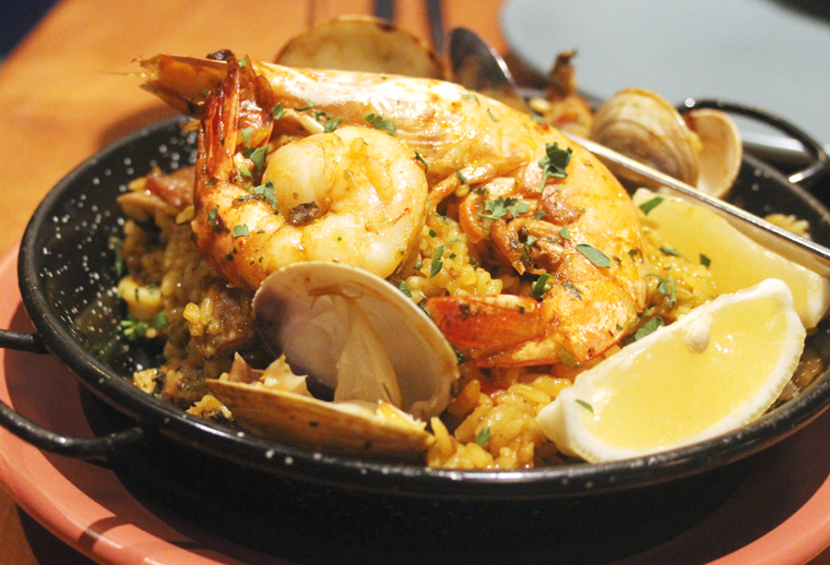 Paella with Mediterranean flavors.
