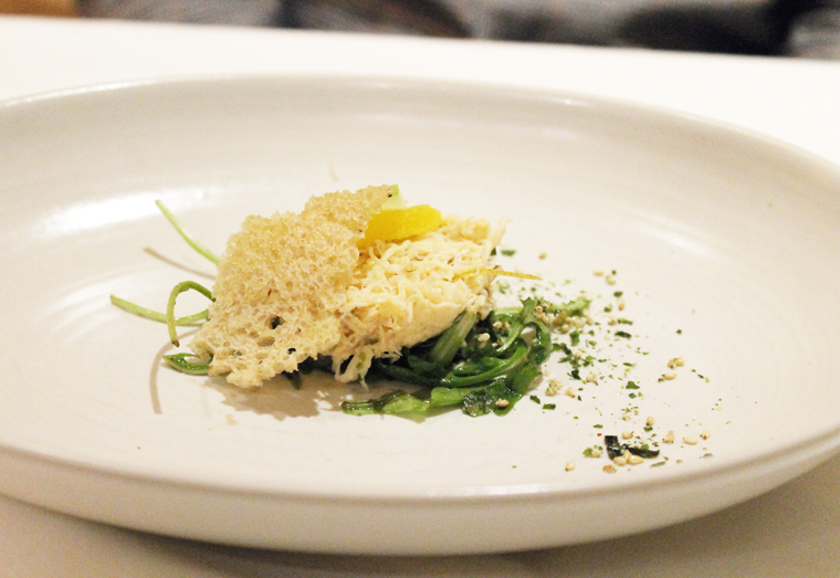Dungeness crab salad with a cheesy crisp on top.