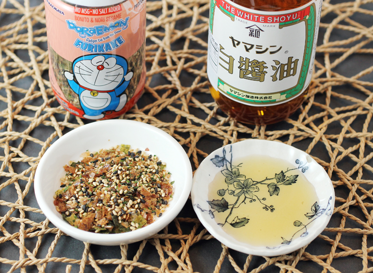 Furikake adds more savory sea flavor, while white soy sauce adds delicate salinity.