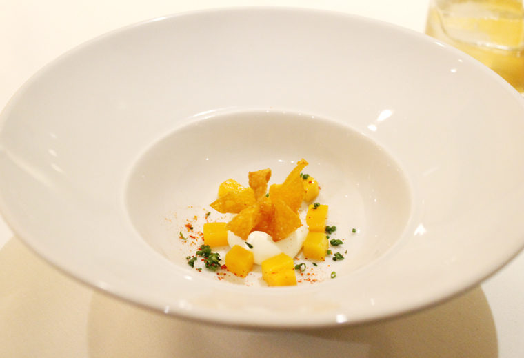Pieces of roasted pumpkin, fried pumpkin and creme fraiche mousse.