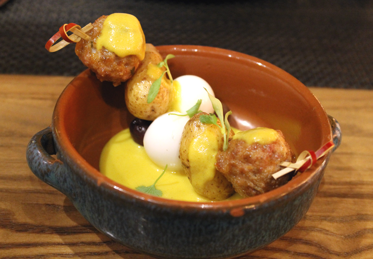 Skewers of chicken meatballs and quail eggs.