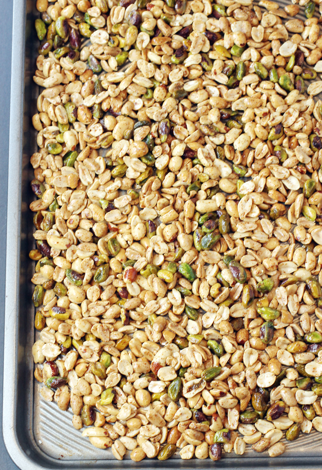 Peanuts and pistachios tossed in spices, and ready to get toasted in the oven.