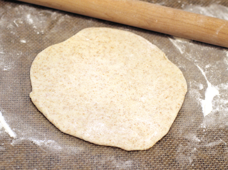 Flattened round of dough.