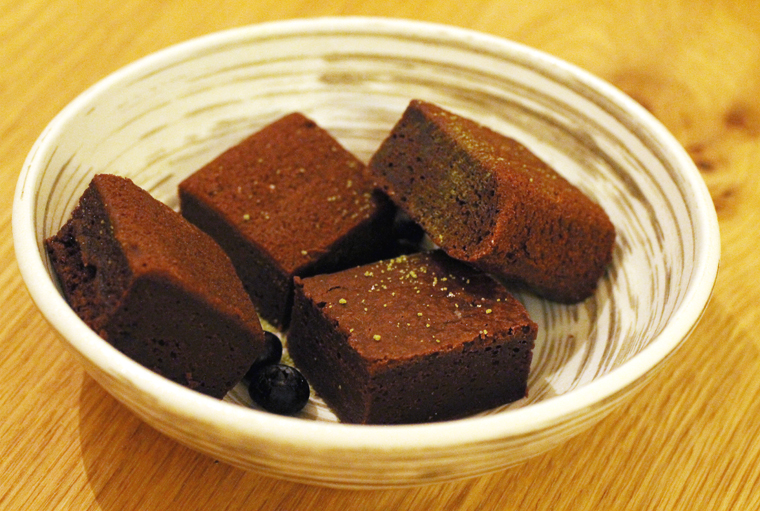 Squares of chocolate mochi cake.
