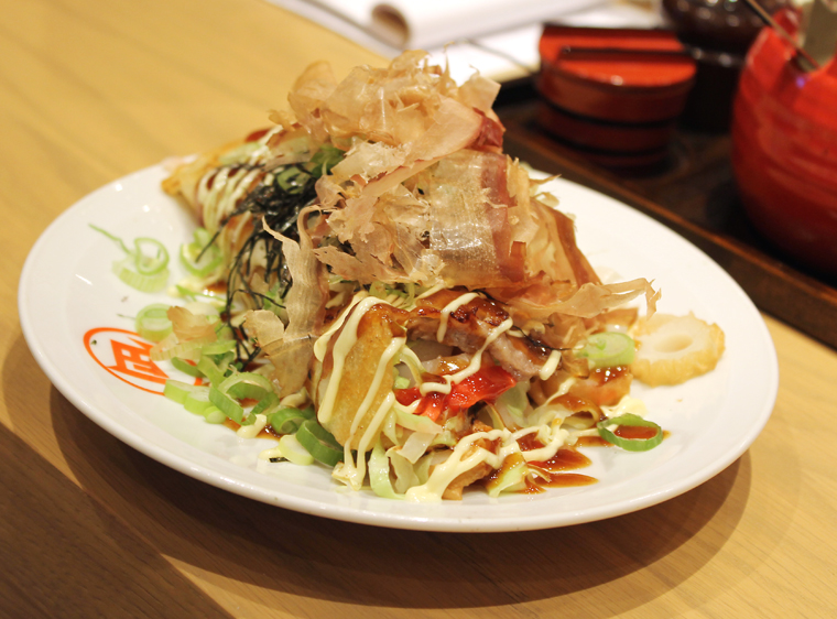A loaded okonomiyaki.