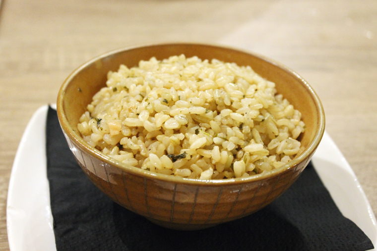Brown rice gilded with butter.