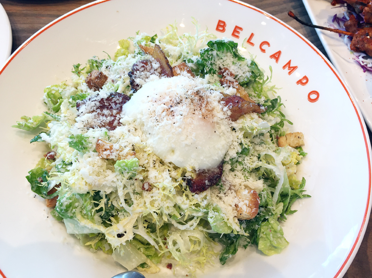 Bacon-garnished Caesar salad.